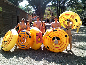 tourists cave tubing